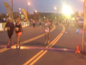 crossing the finish line. Lori G took this. THANKS LORI-- my mood changed when I saw friends.